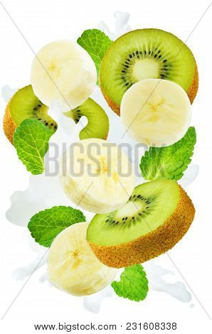 Flying Kiwi And Banana With Mint Leaves And A Spray Of Milk Isolated