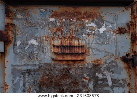 Old Rusty Peeled With Gray Paint And For Ventilation Iron Box Close-up