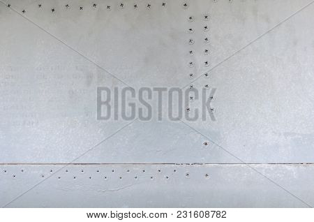 Background Of Old Sheet Iron Fastened With Rivets