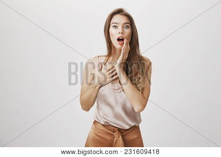Hearing Shocking News That Sweep Girl From Feet. Portrait Of Surprised And Thrilled Attractive Woman
