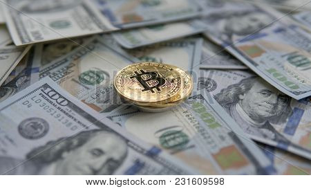 Two Golden Bitcoins On Us Dollars. Digital Currency Close-up. New Virtual Money. Crypto Currency Top