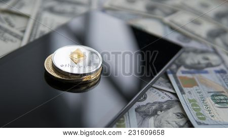 Ethereum Coin On A Golden Bitcoins And Tablet On Us Dollars. Digital Currency Close-up. New Virtual