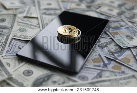 Bitcoins On A Us Dollars And On The Tablet. Bitcoin Crypto Currebcy On Us Dollars. Digital Currency.