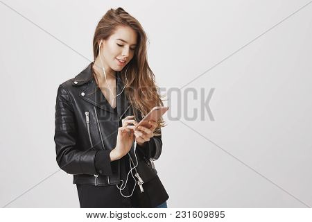 Texting Client While On Her Way To Meeting. Shot Of Charming Feminine Woman Holding Smartphone, Typi