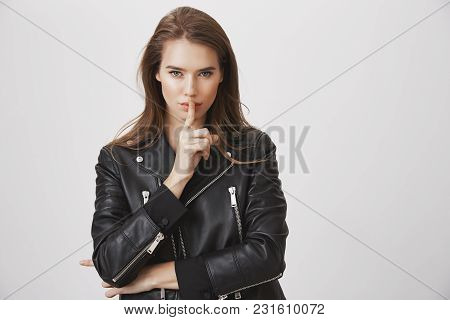 Shh, Listen To Me. Attractive Beautiful European Woman Holding Index Finger Over Mouth, Looking Sens