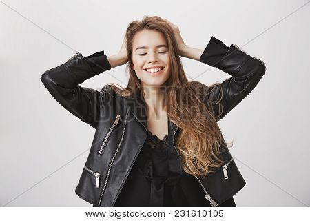Feeling Independent And Carefree. Upbeat Attractive Caucasian Female Holding Hands On Head, Closing