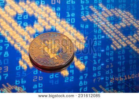 Golden Bitcoin On Blue High Tech Background
