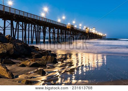 The Oceanside, California Fishing Pier With Lights At Dawn.