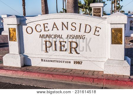 Oceanside, California/usa - February 24, 2018: Sign Marker For The Oceanside Pier Placed At The Entr