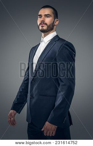 A Stylish Bearded Male Dressed In A Business Suit And A White Shirt.