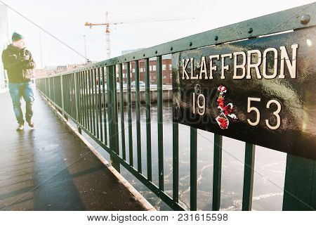 Malmo, Sweden - Dec 29, 2018: Adult Man Walking On The Klaffbron The New Flap Bridge Drawbridge Basc