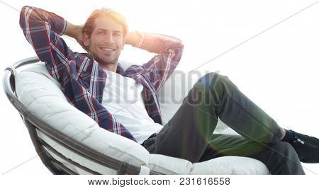 close-up. a successful guy sitting in a large round comfortable