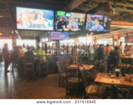 Blurred People At Sports Bars And Restaurants In America