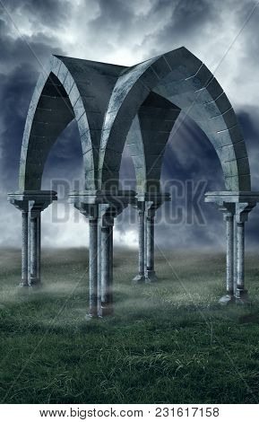 Archway In The Middle Of A Field With Fog And Storm Clouds.