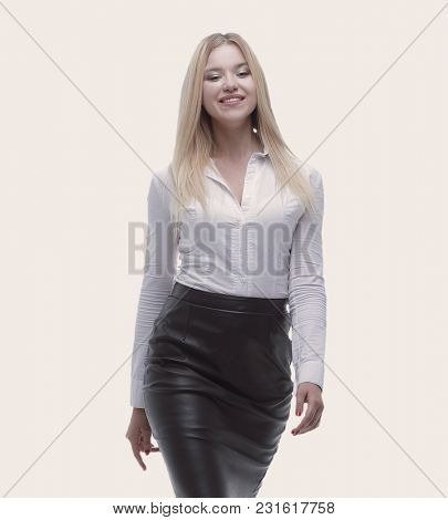portrait in full growth confident young business lady is coming forward.