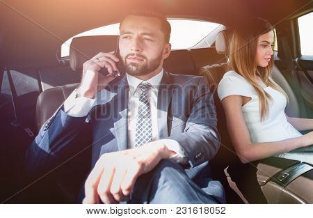 business people using mobile phones and laptop during a trip