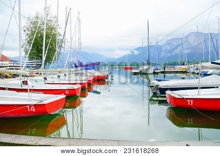 Mondsee Austria-september 6 2017; Red Yachts Ready For Hire And Waiting Tied To Pier On Picturesque