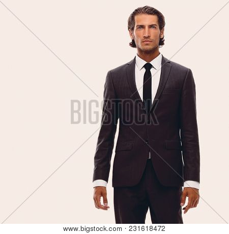 confident young businessman goes forward