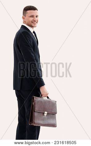 side view.portrait of confident businessman looking at the camer