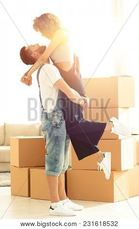 Portrait of a happy couple moving to a new house