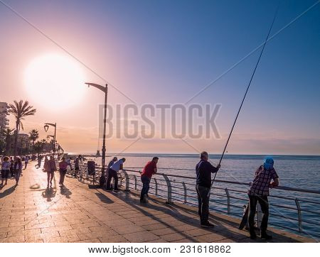 Beirut, Lebanon - May 22, 2017 - Unidentified People Fishing At Sunset On The Seafront Of Beirut.