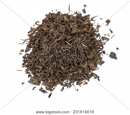 Heap of black tea leaves isolated on white background