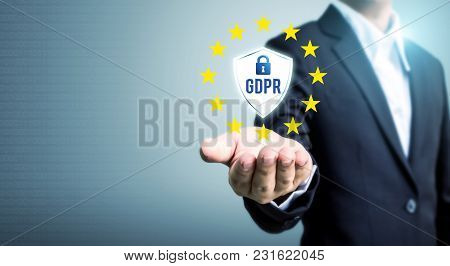 Businessman Hand Holding Sign General Data Protection Regulation (gdpr) And Shield With Key Icon