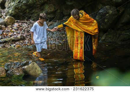 KOH CHANG, THAILAND - MAR 9, 2018: During Christian sacrament of spiritual birth - Baptism. There are currently 10 Orthodox parishes in Thailand, Orthodoxy is practiced by 0.002% of population.