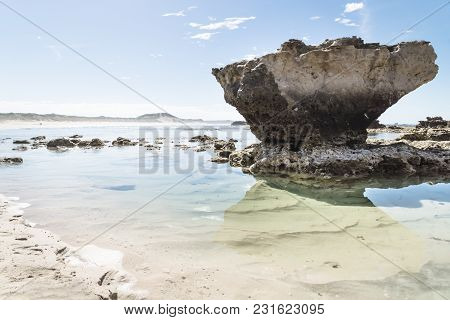 Rock Formation With Reflection And Light Clear Oceanwater At Peterborough Beach Along The Great Ocea