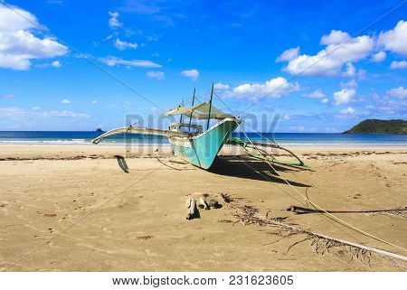 A Traditional Philippine Boat On The Beach Of Nagtabon. The Island Of Palawan. Philippines.