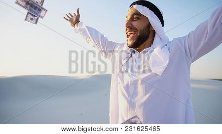 Handsome Young Emirate In Reckless Mood Recounts And Examines Banknotes, Can Not Believe In Own Happ