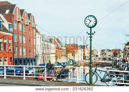 Leiden, Netherlands - April, 5, 2017: Scenic Canal With Traditional Dutch Architecture In Leiden, Ne