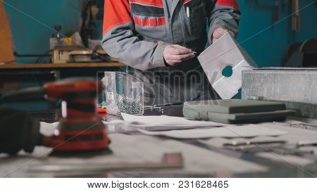 Worker Assembling The Metal Part In The Manual, Industrial Concept