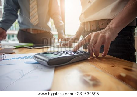 Businessman Working With Calculator. Business People Meeting At Working With Financial Reports
