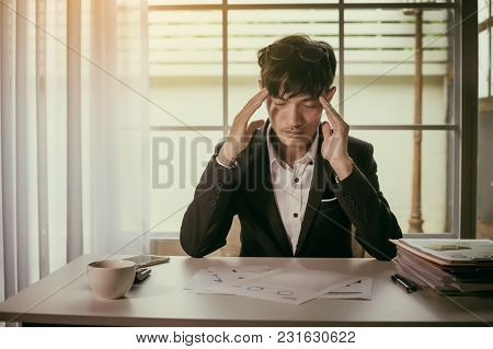 Feeling Sick And Tired. Businessman Who Feel Stressed Out Of Work