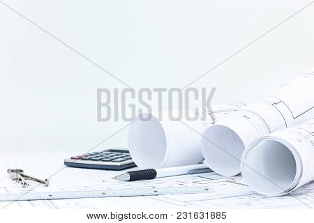 Architect Workplace Background. Blueprints, Roll Plans, Pencil, Drawing Compass And Calculator On De