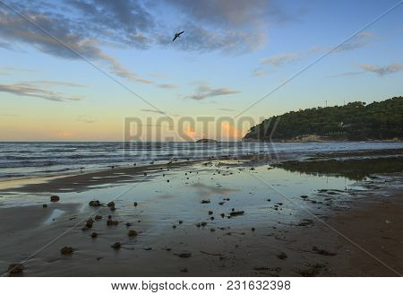 Summertime.gargano Coast:portonuovo Beach (vieste): Waves Breaking On Sandy Shoreline After Sunset.