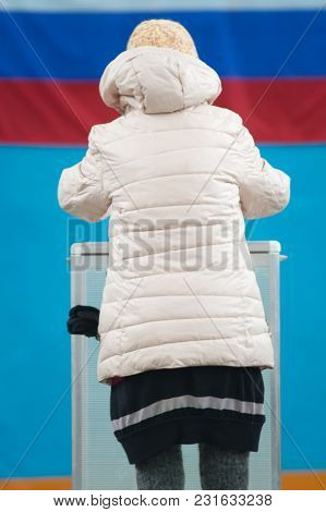 Russian Presidential Election - Woman In Winter Jacket Puts A Ballot Paper To Voting Box, Close Up