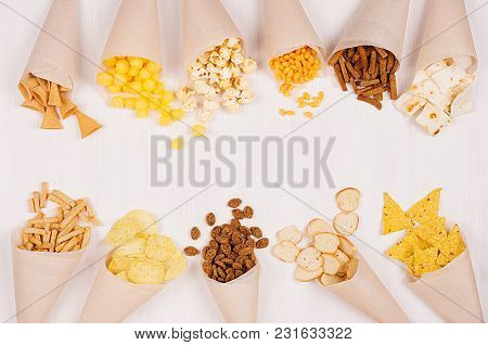 Joyful Summer Snacks Set On Beige Paper Cones On Soft White Wood Background. Top View, Copy Space.