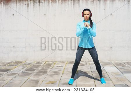Young, Fit And Sporty Girl Stretching In The Street. Fitness, Sport, Urban Jogging And Healthy Lifes