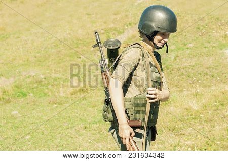 Girl Soldier Armed With Fighting Weapons Outdoors