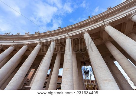 Upward Picture Of Columns Near Papal Basilica Of St. Peter In The Vatican Italy During Beautiful Day