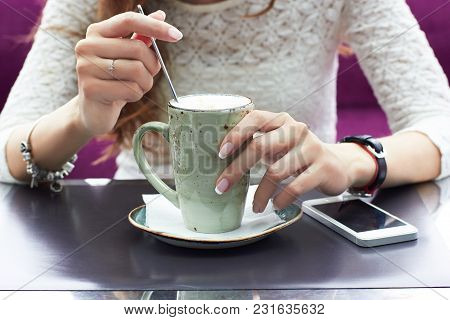 Woman Hands With Latte On A Wood Table.