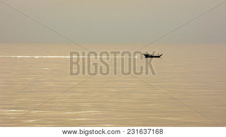 Alone Fishing Boat In Sea At Calm Weather