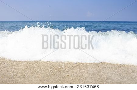 Tropical Sea Sand Beach On Clear Sunny Day. View Of The Sea And Waves From A Tropical Beach On Hot S