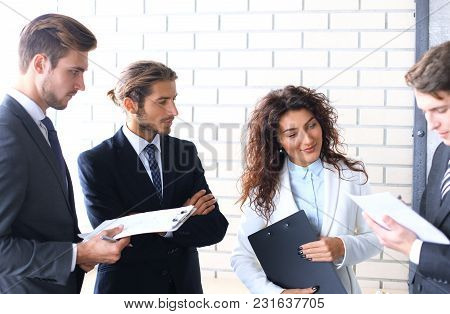 Group Of Business People Discussing Ideas At Meeting