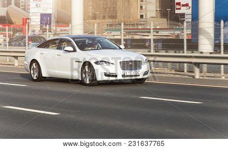 Dubai, Uae February 20, 2018: White Jaguar Rides On The Road