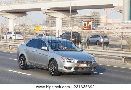 Dubai, Uae February 20, 2018: Mitsubishi Lancer Rides On The Road