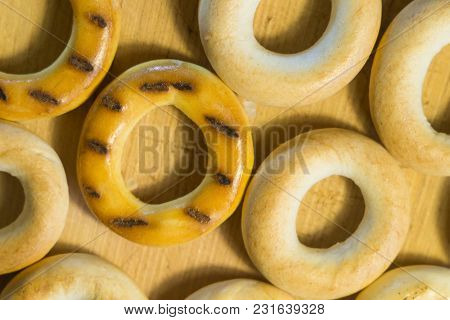 Close-up Photo Of Close-up Of A Bagel Macro On A Wooden Board