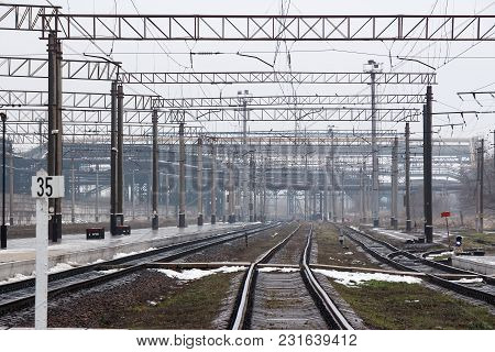 Railway Rails Go Into The Distance Of The Railway Station And The Industrial Zone.